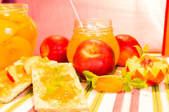 Fresh peaches and peach jam. Royalty Free Stock Photography
