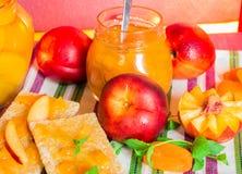 Fresh peaches and peach jam. Royalty Free Stock Image