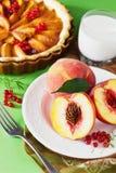 Fresh peaches and peach pie Royalty Free Stock Photos