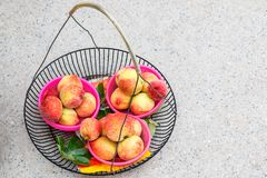 Fresh peaches sale in a asia market royalty free stock photography
