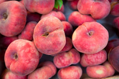 Fresh peaches selling in a market Stock Images