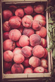 Fresh peaches selling in a market Royalty Free Stock Photography