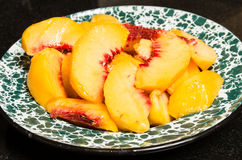 Fresh peaches sliced into a bowl Royalty Free Stock Photo