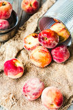 Fresh peaches in a tin, selective focus,healthy raw food Stock Image