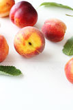 Fresh peaches on white boards Royalty Free Stock Image