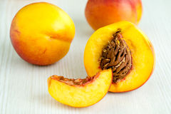 Fresh peaches on white table Royalty Free Stock Photos