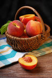 Fresh peaches in a wicker basket Royalty Free Stock Images