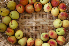 Fresh peaches in a wicker basket. Some fresh peaches in a wood basket Royalty Free Stock Photo