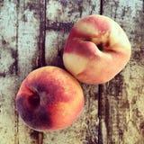 Fresh peaches on wood Royalty Free Stock Image