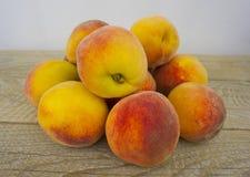 Fresh peaches on wood background Royalty Free Stock Image