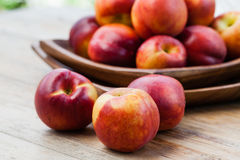 Fresh peaches. On wood background Stock Photography