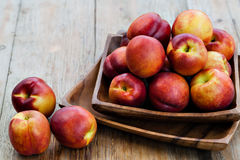 Fresh peaches. On wood background Stock Images