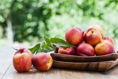 Fresh peaches. On wood background Royalty Free Stock Image