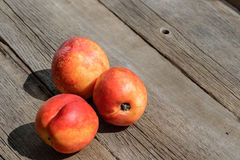 Fresh peaches on wood background Stock Photo