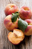 Fresh peaches on wood background Stock Photos