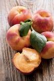 Fresh peaches on wood background Stock Photos