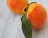 Fresh peaches on wood background Royalty Free Stock Photo