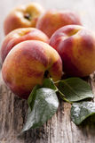 fresh peaches on wood background Royalty Free Stock Photography