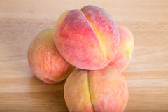 Fresh Peaches on a Wood Table Stock Photo