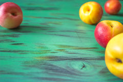 Fresh peaches on wooden background. Fresh peaches on green wooden background. texture Royalty Free Stock Photography