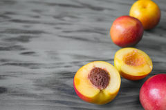 Fresh peaches on wooden background. Fresh peaches on grey wooden background. texture Stock Photo