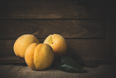 Fresh peaches on wooden board Stock Image
