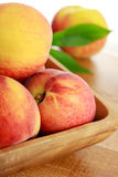 Fresh Peaches. In a Wooden Bowl Royalty Free Stock Photography