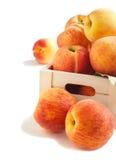 Fresh peaches in wooden box Stock Photos