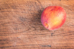 Fresh peaches on a wooden cutting board. Royalty Free Stock Photo