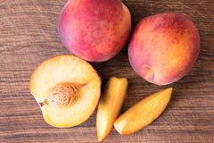 Fresh peaches on a wooden cutting board. Stock Photography