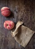 Fresh peaches on the wooden floor Stock Image