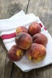 Fresh peaches on wooden table Royalty Free Stock Photos
