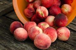 Fresh peaches on wooden table Stock Photos