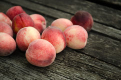 Fresh peaches on wooden table Stock Photos