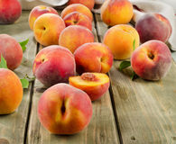 Fresh peaches on a wooden table Stock Images
