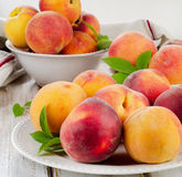 Fresh peaches on a wooden table Royalty Free Stock Image