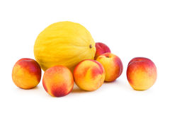 Peaches and melon on white Royalty Free Stock Photography
