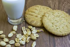 Fresh peanut butter cookies on wooden boards with milk Stock Photography