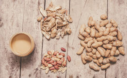 Fresh peanuts, shells, raw nuts and peanut butter Stock Photo