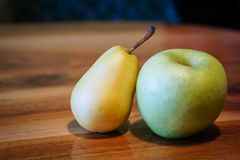 Fresh pear and apple. On wooden table Royalty Free Stock Photography
