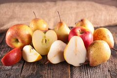 Fresh pear and apple. On wood Royalty Free Stock Photography