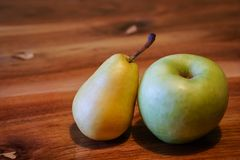 Fresh pear and apple. On wooden table Royalty Free Stock Images