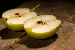 Fresh pear cutted  in half Royalty Free Stock Photos
