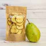 Fresh pear and dried pieces Stock Image