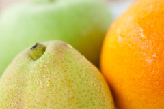 Fresh pear, orange and green apple Stock Image