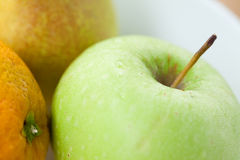 Fresh pear, orange and green apple Stock Images