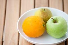 Fresh pear, orange and green apple Royalty Free Stock Image