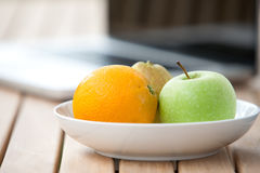 Fresh pear, orange and green apple Royalty Free Stock Images