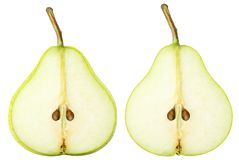Isolated sliced pears. Two yellow green pear fruits slices isolated on white background with clipping path royalty free stock image