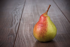 Fresh pear on the wooden table Stock Images